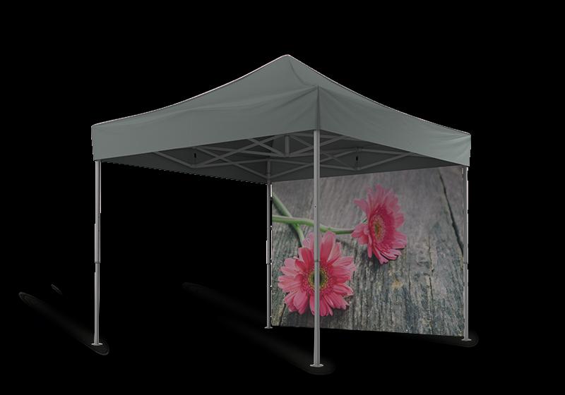 Graues Gartenzelt 3x3 m mit 2 rosaroten Gerbera auf der geschlossenen Seitenwand hinten.