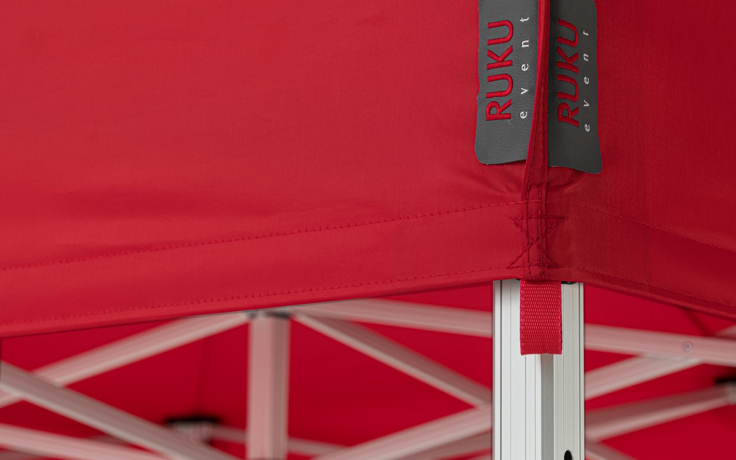 Red canopy tent roof with gray label from RUKUevent.