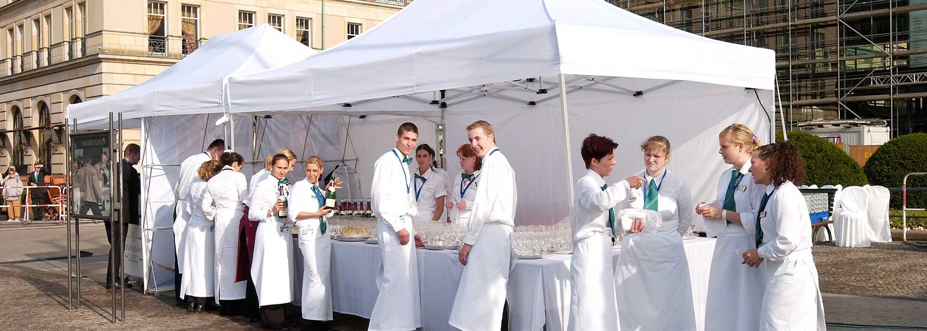 White canopy tent with chefs and buffet