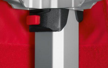 Schwarz-roter Druckknopflöser für atento Faltpavillons damit es kein Einklemmen mehr gibt beim Schließen.