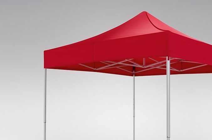 Red canopy tent on a grey background.