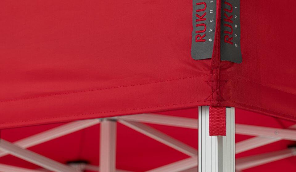 Rotes Faltpavillon-Dach mit grauer Etikette von RUKUevent.