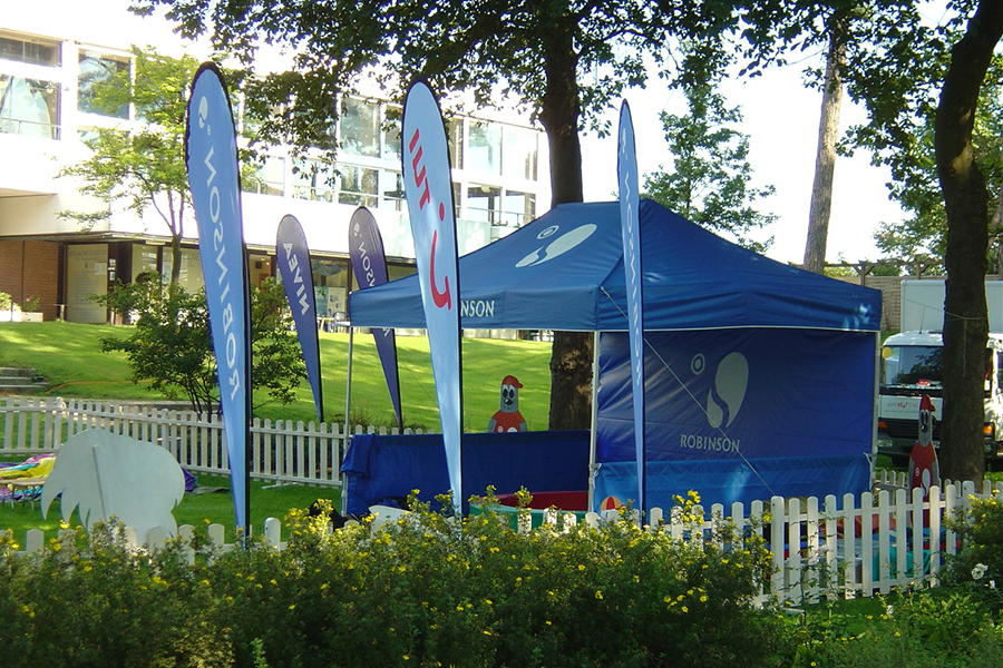 Blue garden tent of Robinson and TUI in the garden of a holiday resort.