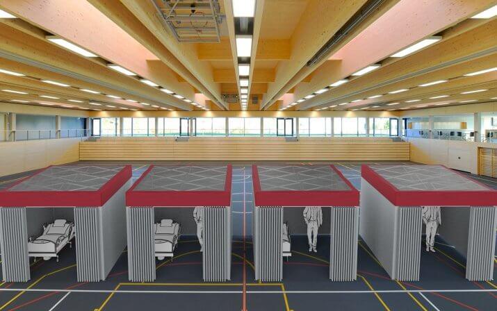 Ein 3D-Rendering der mobilen Patientenräume in einer Turnhalle.