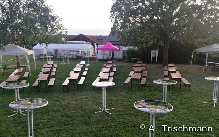 Poseur tables and folding tabels and benches at the kids festival.