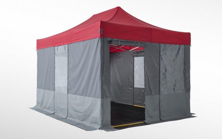 Rot-graues Sanitätszelt bestehend aus einem klassischen Faltpavillon, verlängerten Seitenwänden, verschließbaren Fenstern und einem rutschfesten Boden.